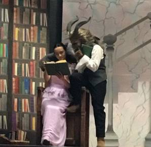 Musical/belle___beast_in_the_library_1532952123.jpg
